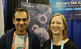 Kathryn Mohror and fellow researcher in front of scientific poster